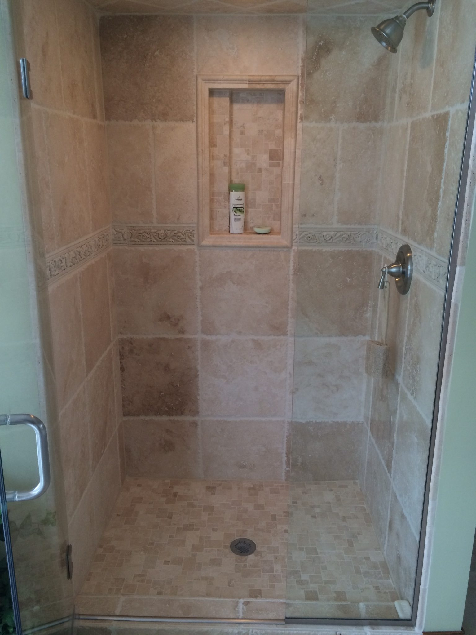 Custum Tile Shower Remodel - We love the intricate detail work we were able to incorporate into this bathroom remodel.