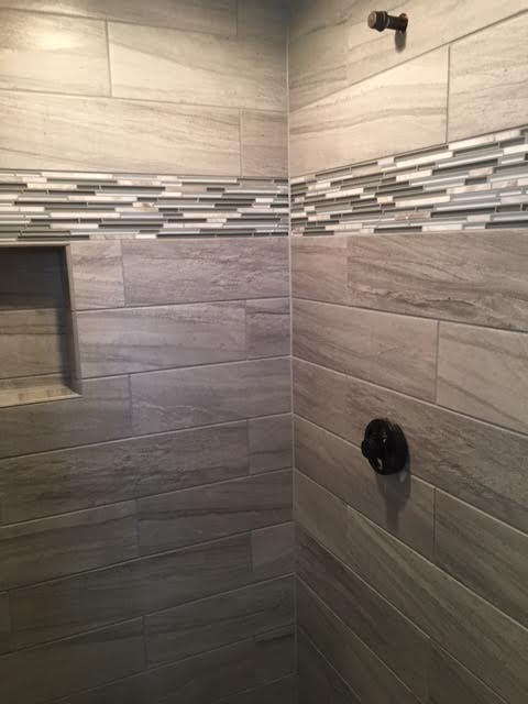 Custom Tile Shower Stall - We love how great this modern shower remodel turned out.