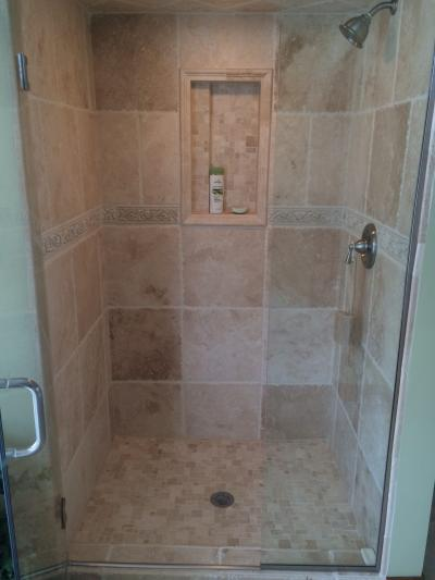 Custum Tile Shower Remodel We love the intricate detail work we were able to incorporate into this bathroom remodel.