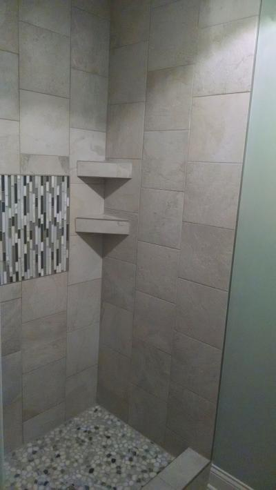 Custom Tile Shower Shelves These tile shelves give this shower stall a very modern look.
